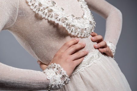 ladylike: Detail of white knitted dress