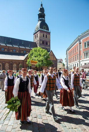 choral: Riga, Latvia - July 07 2013:  People in national costumes at the Latvian National Song and Dance Festival on July 07, 2013. Holiday was hold from 30th June 2013 till the 7th July 2013.