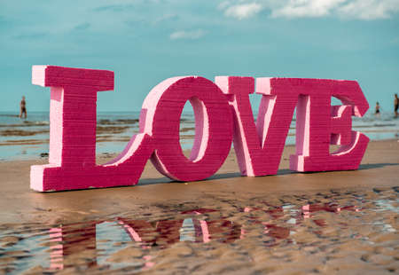 The word LOVE on the beach photo
