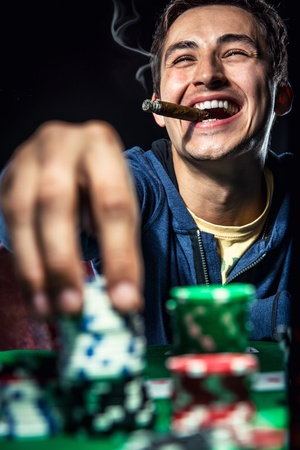 smoking cigar: Cheerful poker player