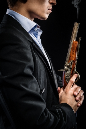 gangster with gun: Man with musket Stock Photo