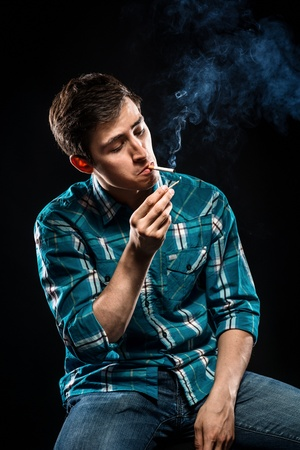 evil: Young man smoking cigarette