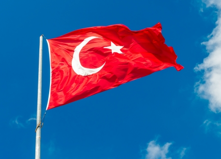 turkish flag: Waving flag of Turkey over blue sky background