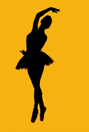 pirouette: Black silhouette of ballerina isolated over yellow background Stock Photo