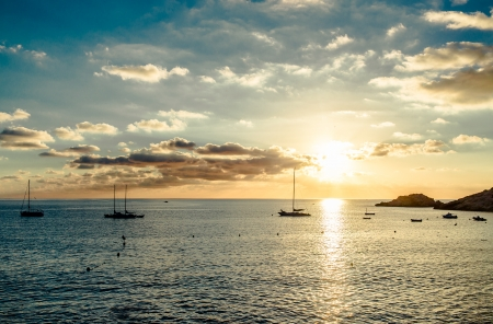 Magnificent sunset above the Mediterranean Sea and sailboats silhouette  Ibiza, Spain Stock Photo - 22973748