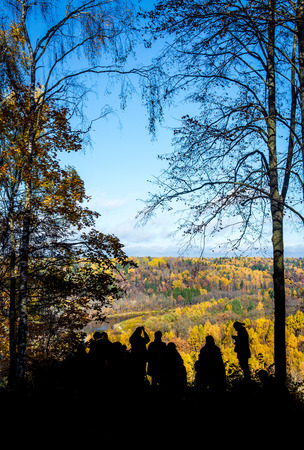 Picturesque autumn landscape and tourists silhouettes  Sigulda, Latvia Stock Photo - 22974274