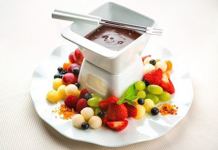 Chocolate fondue with fresh fruits and berries  photo