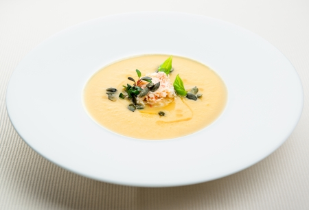 Pumpkin crab soup on a white bowl photo