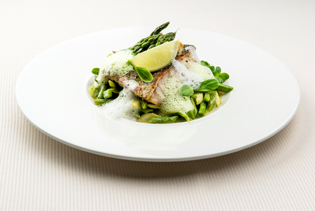 sea bass: Sea bass fillet with asparagus infused with sauce foam