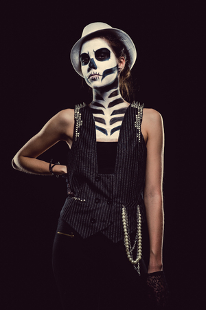 body paint: Woman with skeleton face art over black background