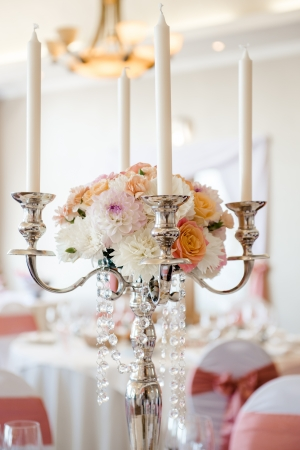 candle holders: Wedding candlestick with flower decoration Stock Photo