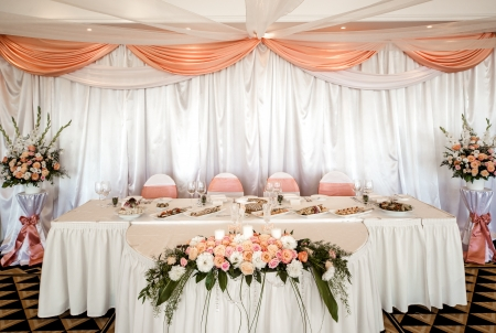 Wedding chair and table setting at restaurant photo