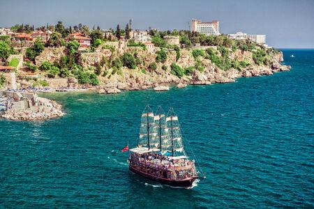 Cruise touristic ship  and view of Antalya city, Turkey