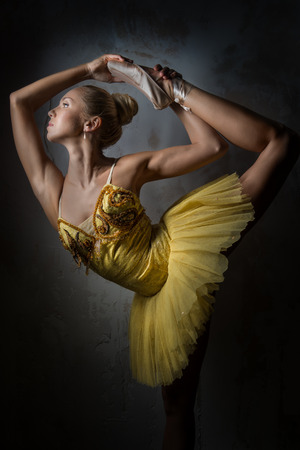 Lovely ballerina in yellow tutu photo