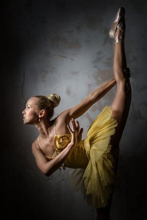 Lovely ballerina in yellow tutu photo