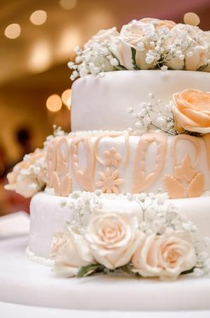 wedding party: Beautiful wedding cake decorated with orange roses