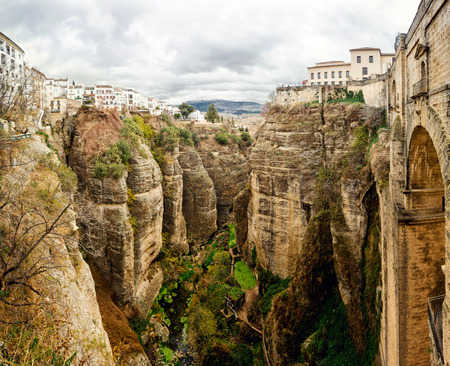 andalusia: Amazing view of the Ronda canyon and the famous white village in Province of Malaga, Andalusia, Spain Stock Photo