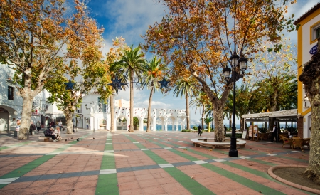 NERJA, SPAIN-DECEMBER 14, 2013: View of Balcon de Europa, spanish landmark in Nerja. Costa del Sol on the south coast.  Its completely pedestrianised and it is lined with cafes and restaurants on december 14, 2013