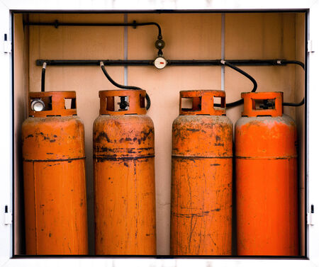 butane: Fours gas container Stock Photo