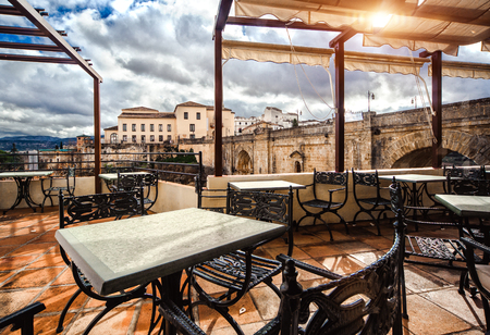 andalusia: View from the terrace cafe on the Ronda landmark-Puente Nuevo  Province of Malaga, Andalusia, Spain Editorial