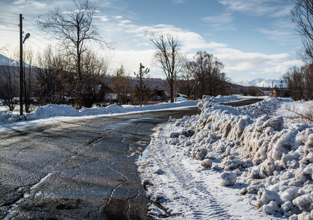 snowdrifts: Snowdrifts and rural road  Petropavlovsk-Kamchatsky in march  Kamchatka, Russia