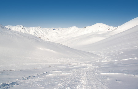 snowbanks: Pinachevsky pass, route through a ridge in Kamchatka  Russia