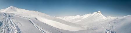 snowbanks: Pinachevsky pass, route through a ridge in Kamchatka  Far East, Russia