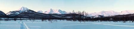 snowbanks:  Sunrise over Nalychevo Nature Park and Koryaksky volcano  Kamchatka peninsula, Russia Stock Photo