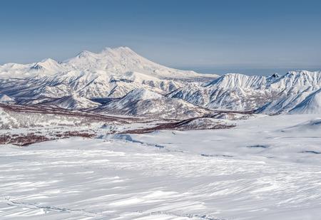 snowbanks: View of Nalychevo Nature Park and Zhupanovsky volcano  Kamchatka, Far East  Russia Stock Photo