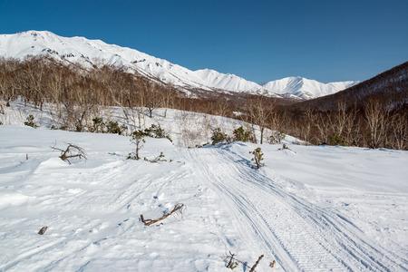 snowbanks: Mountain pass, route over a ridge  Kamchatka peninsula; Russia Stock Photo