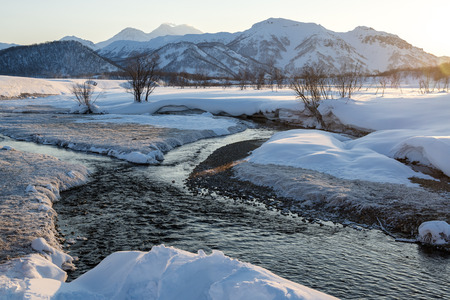 snowbanks: View of Nalychevo Nature Park and Zhupanovsky volcano at sunrise  Kamchatka, Far East  Russia