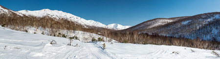 snowbanks: Panoramic view of a mountain pass, route over a ridge  Kamchatka peninsula, Russia