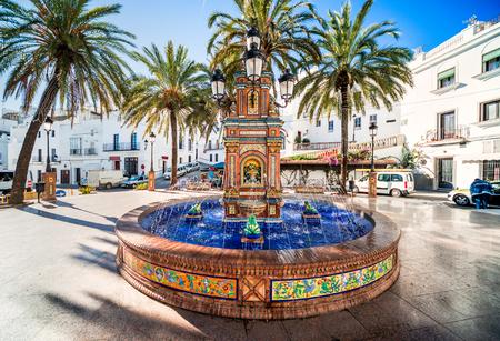 architectural feature: The main square in Vejer de la Frontera is Plaza de Espana, featuring a beautiful fountain with colorful ceramic tiles. Stock Photo