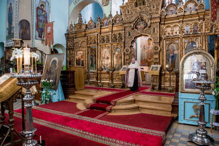 sacred trinity: RIGA, LATVIA-SEPTEMBER 13: Priest inside of The Cathedral of the Holy Trinity. It is an Orthodox cathedral. Most visited and beloved by the people on september 13, 2013 Editorial