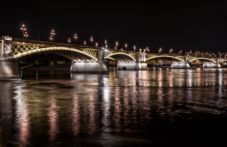 Margaret Bridge across the Danube river by night  Budapest, Hungary photo