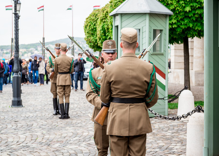 solders: BUDAPEST, HUNGARY-17  april, 2014: Changing of the Guards in the Buda Castle,  one of the Buda Castle attractions on april 17, 2014