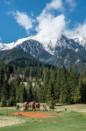 Picturesque landscape with empty playground and High Tatras  Slovakia photo