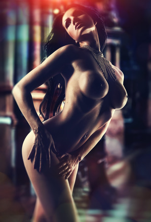 Naked brunette over abstract background photo