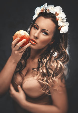Beautiful seductive woman with apple, conceptual photo photo