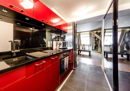 Interior of modern red kitchen   photo