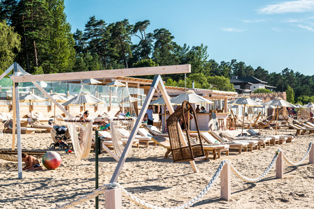 jurmala: Jurmala, Latvia-July 19, 2014: People relaxing on Legend beach in resort town Jurmala, on a hot summer day, 30C outside on july 19, 2014