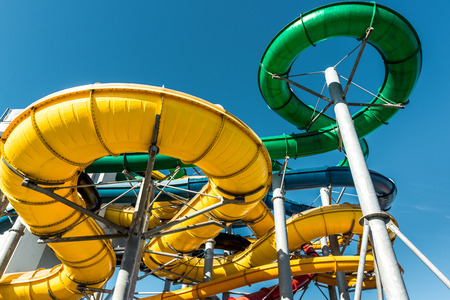 water park: Tube slides at water park against blue sky Editorial