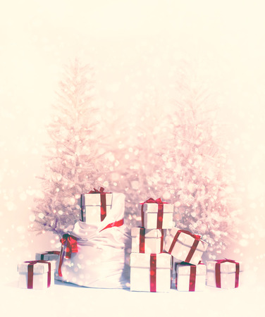Christmas trees with heap of gift boxes  photo