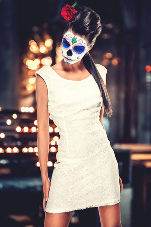 Day of the dead girl with sugar skull makeup   photo