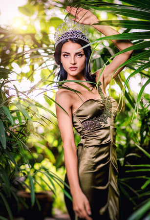 Gorgeous lady in long evening dress and with tiara on a head photo
