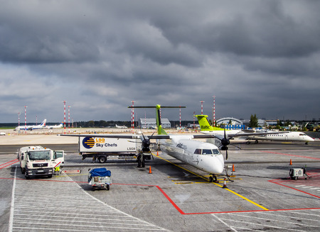 industry moody: Latvia, Riga- September 10, 2014: Preflight service of the plane of airline Airbaltic at the Riga International Airport
