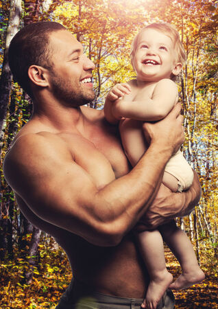 Loving father with daughter against forest background  photo