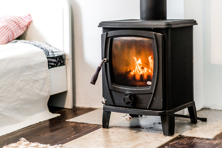 wood stove: Wood burning stove in bedroom