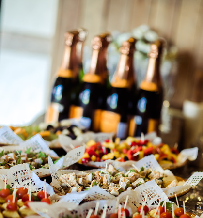 holiday catering: Table with appetizers for guests reception Stock Photo