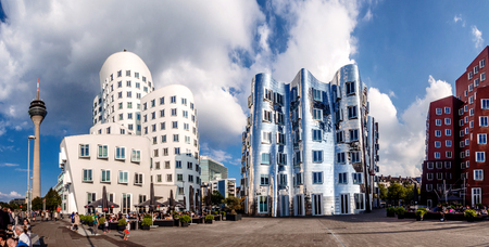 tourist feature: Dusseldorf, Germany- september 14, 2014: Panoramic view of three futuristic building Neue Zollhof located in Media Harbor.This building complex was designed by Frank O. Gehry and completed in 1998.